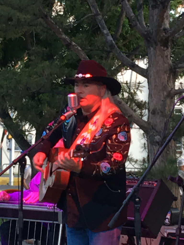 Steve Griggs performs live on stage, close up view.